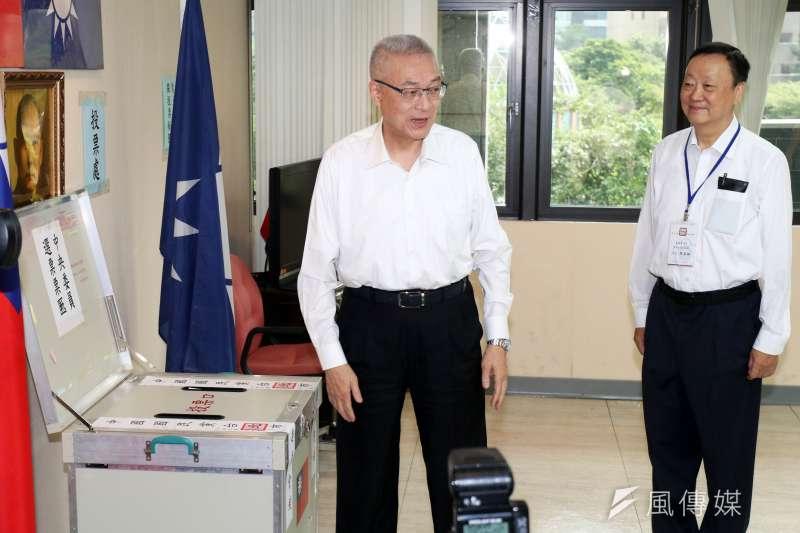 國民黨主席吳敦義中國國民黨中央委員選舉投票,但黨部主委直選方面可能要跳票了。(蘇仲泓攝)