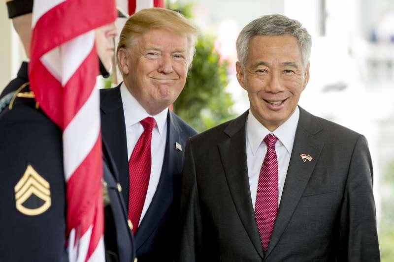 新加坡總理李顯龍23日造訪美國總統川普。(美聯社)