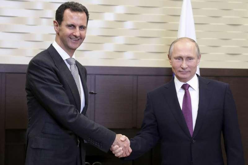 俄羅斯總統普京與敘利亞總統阿塞德。(美聯社)