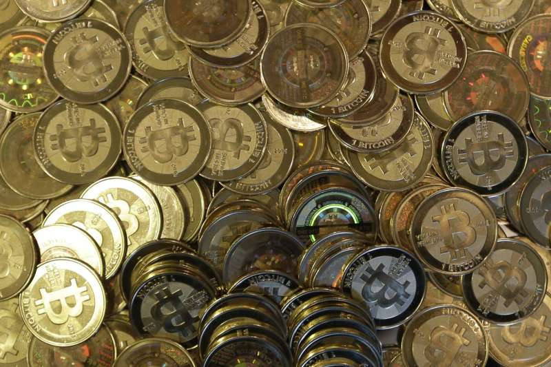 以比特幣做為開端的數位虛擬貨幣興起趨勢,正在改變全球金融規則與秩序。(資料照,美聯社)