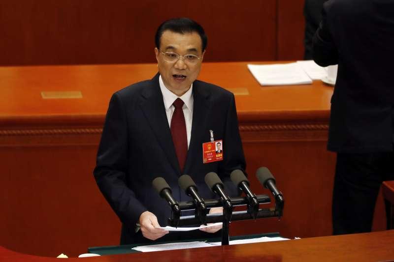 2018-03-05-中國大陸13屆全國人大今日上午開幕,國務院總理李克強發布政府工作發告。(美聯社)