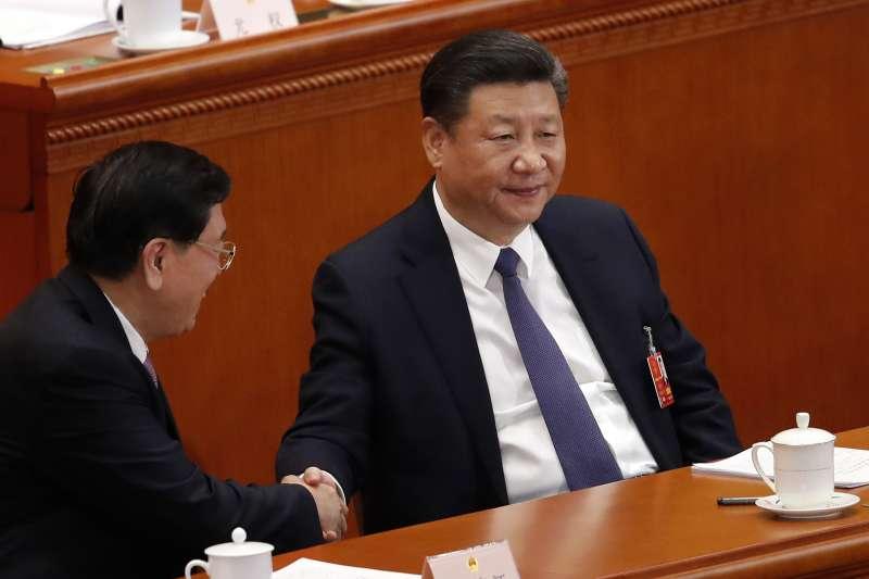 2018年3月11日,中國第十三屆全國人大一次會議表決通過包括取消國家主席任期在內的修憲案,習近平權勢如日中天。(資料照,美聯社)