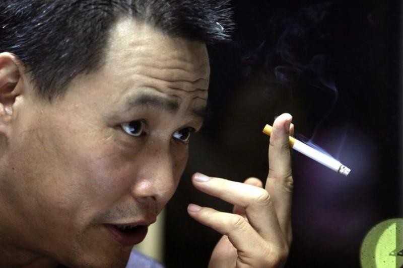 中國維權律師浦志強13日被正式逮捕,此前被拘禁。(美聯社)(吸菸有礙人體健康)