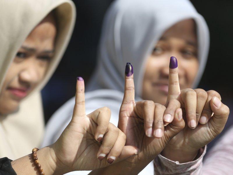 印尼,雅加達選舉,鍾萬學,阿尼斯,投票。(美聯社)