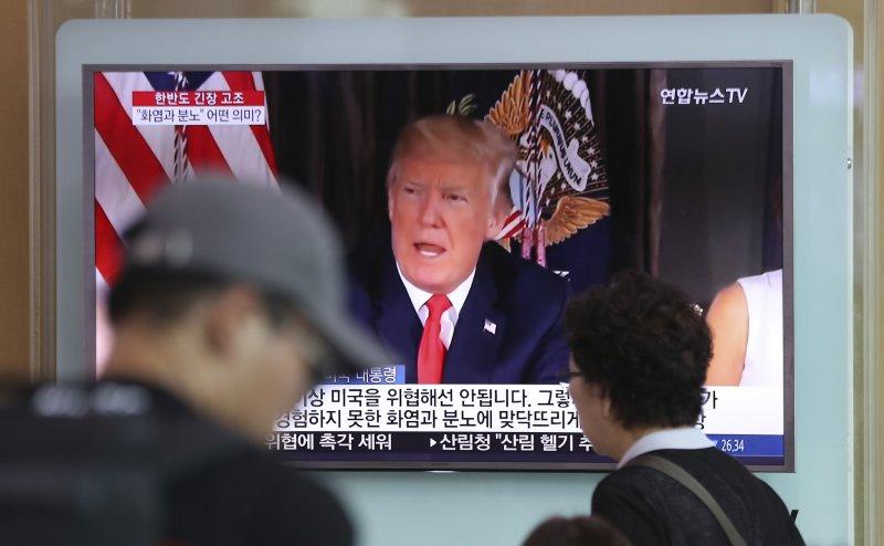 川普揚言要讓北韓嘗到「火與怒」的新聞,已成為南韓新聞關注的焦點。(美聯社)