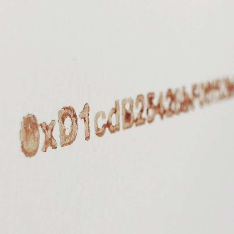 愛爾蘭攝影家艾伯許(Kevin Abosch)的藝術虛擬貨幣「IAMA Coin」。(Kevin Abosch)