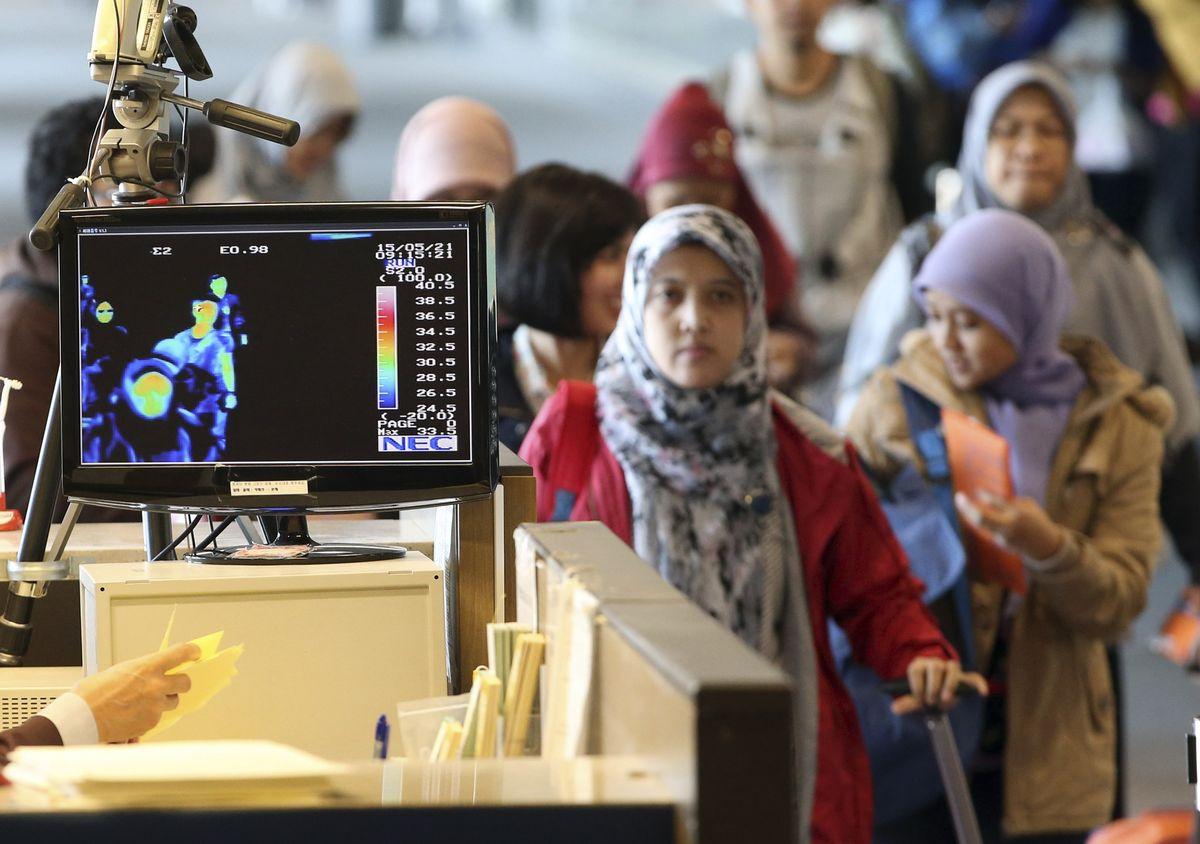 中東呼吸症候群冠狀病毒(MERS-CoV)威脅南韓,仁川國際機場加強體溫篩檢。(美聯社)