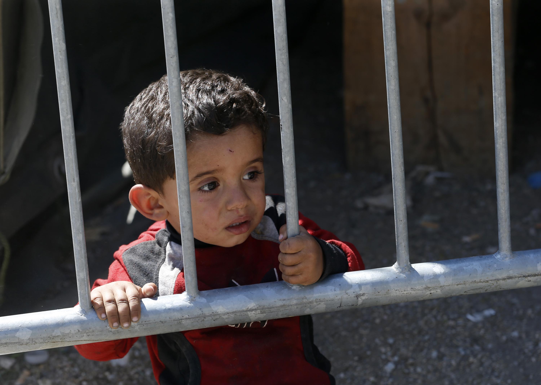 塞爾維亞的敘利亞移民男童(美聯社)