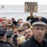 梅克爾出席「德國統一日」慶典 反移民人士鬧場喊「滾蛋」