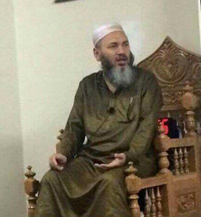13日遭人當街槍殺的清真寺教長阿孔基。(美聯社)