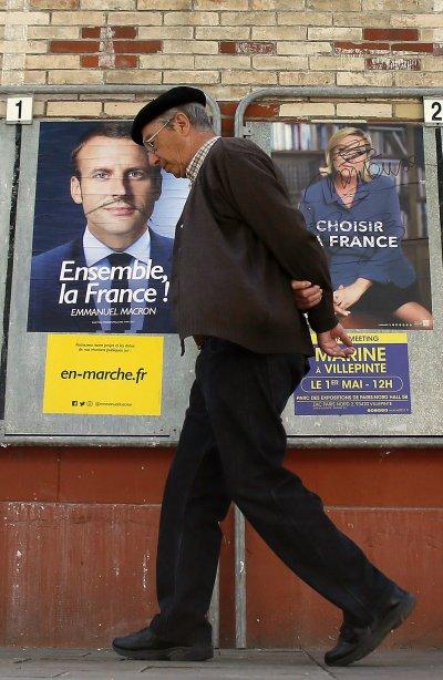 勒潘與馬克宏的政見幾乎完全相反,因為兩人的核心理念背道而馳。(美聯社)