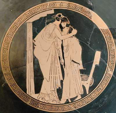 大叔與少年接吻。(圖/維基百科)