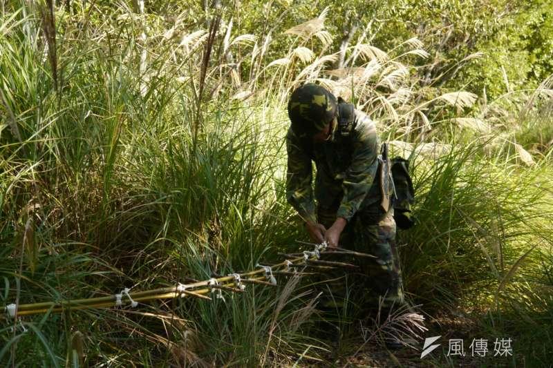 利用削尖的樹枝和竹子做成陷阱,殺傷力強大,是山地連必學習技能之一。(朱明)