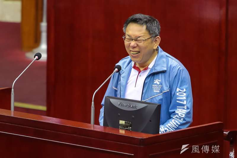 台北市長柯文哲12日於市議會備詢時突然大笑(顏麟宇攝)