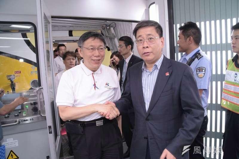 雙城論壇將在20日舉行,圖為台北市長柯文哲(左)與上海市台辦主任李文輝(右)。(北市府提供)