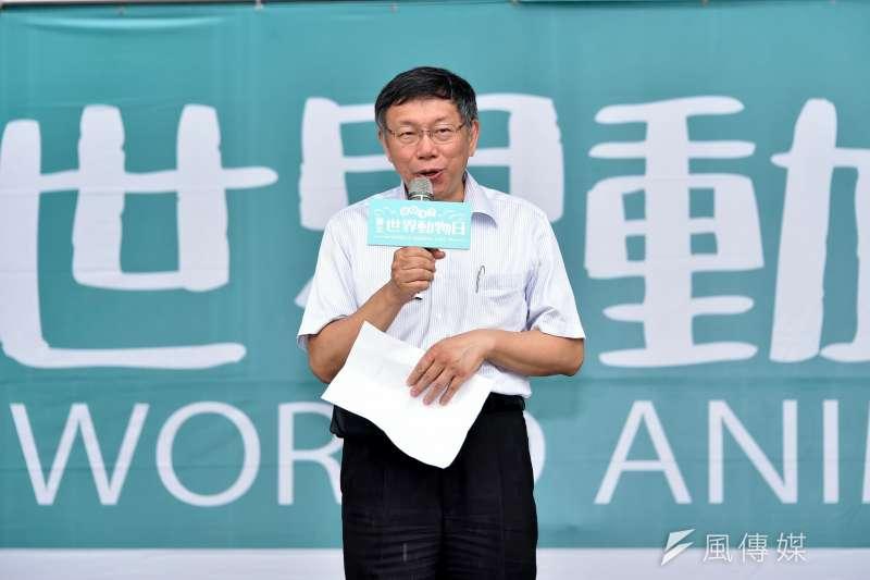 台北市長柯文哲接受廣播專訪,談到民進黨最近頻頻攻擊,他無奈表示「都快變深紅了」。(資料照,台北市政府提供)