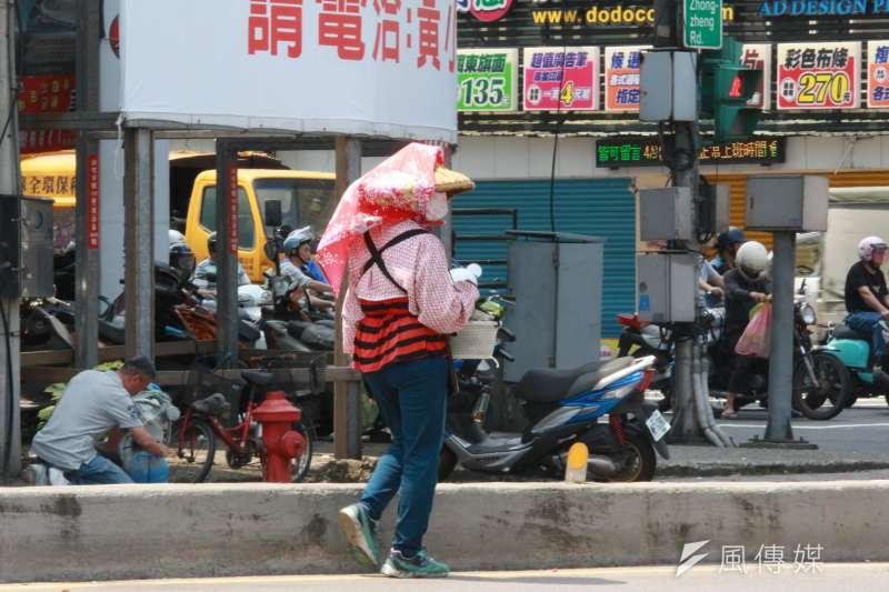 6月還沒過完,台北氣象站全月測到超過攝氏37度、38度的天數,皆已創下設站124年來紀錄。(資料照,陳韡誌攝)