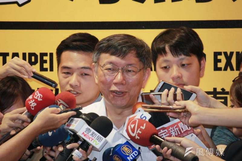 20180623-台北市長柯文哲23日上午前往華山文創,出席台北勞工技藝博覽會,而僅隔一條街,就是對手姚文智晚間將進行大型晚會的場地。柯文哲會後接受聯訪。(方炳超攝)