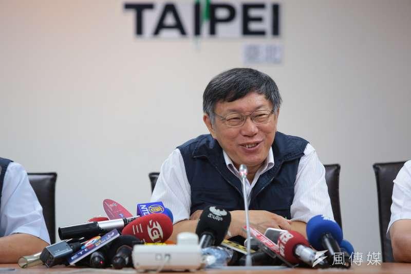 柯P因尊重專業而不放颱風假,台北市民的反應兩極。(圖/顏麟宇攝)