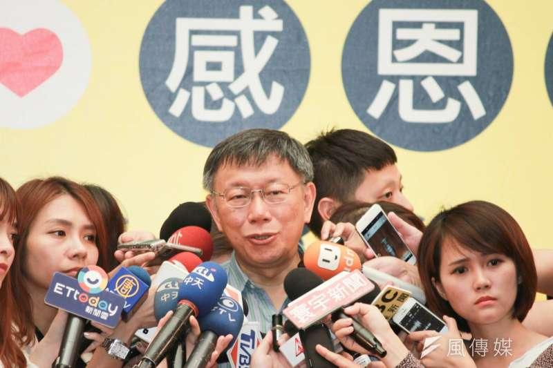 台北市長柯文哲下午前往時力中山大同區議員參選人林亮君競選總部成立,並接受媒體採訪。(方炳超攝)