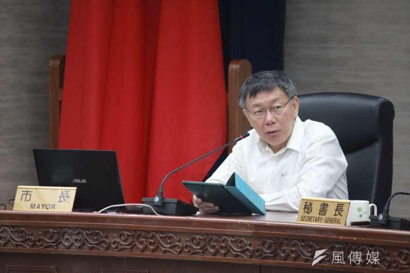 台北市長柯文哲說,北市1年以上沒人居住空屋有3萬多戶,但包租代管僅400多戶,這要用稅的方式解決。(方炳超攝)