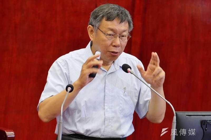 總統大選藍綠相爭,台北市長柯文哲的民調支持度有的超前有的墊底,莫衷一是。(盧逸峰攝)