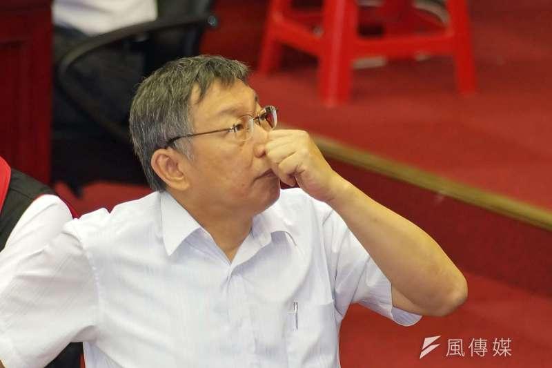 台北市長柯文哲29日出席台北市議會市政總質詢,會中被藍營議員詢問若真要選總統,是否會帶職參選?對此,柯文哲僅回應,到時候再講。(盧逸峰攝)