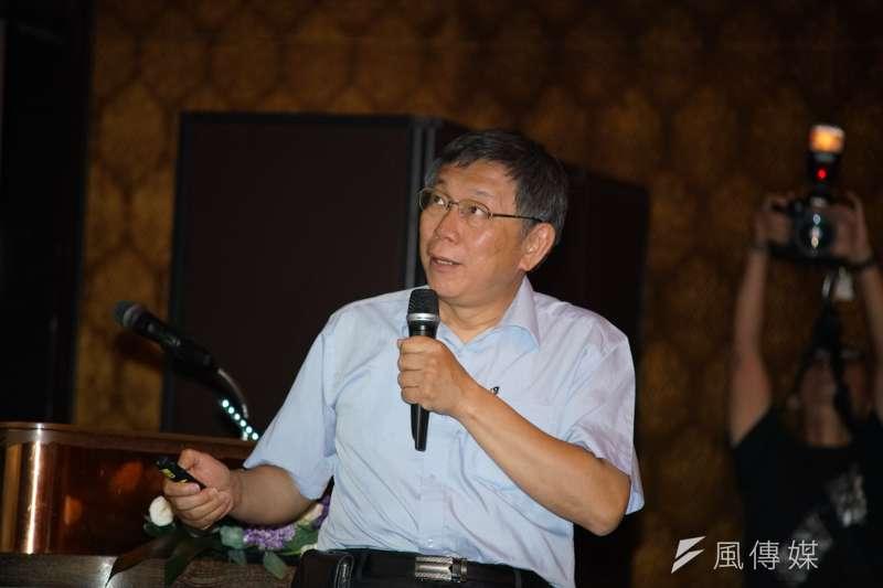 台北市長柯文哲(見圖)爆料,「當年弄這麼多大學,李登輝把李遠哲罵到臭頭。」(盧逸峰攝)
