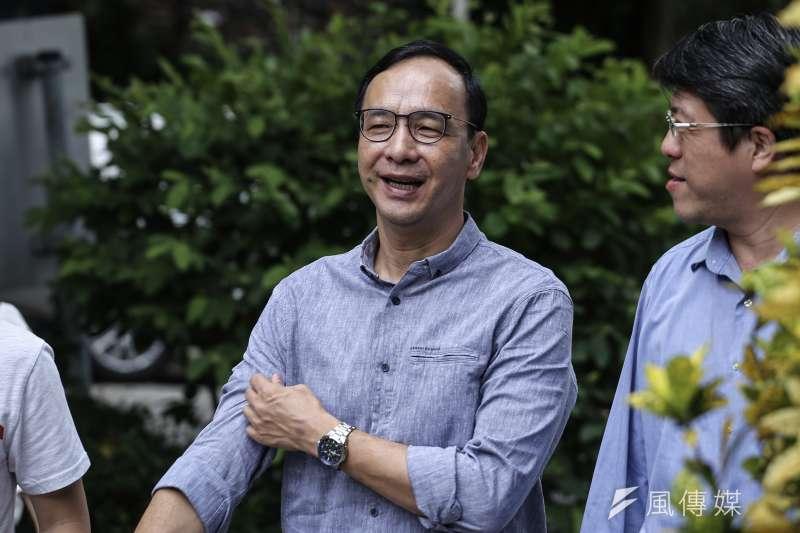 前新北市長朱立倫(中)說,台灣平均稅率約為12%,不想繳這麼高的稅,又要孩童交給國家養,事實上不可能。(資料照,陳品佑攝)