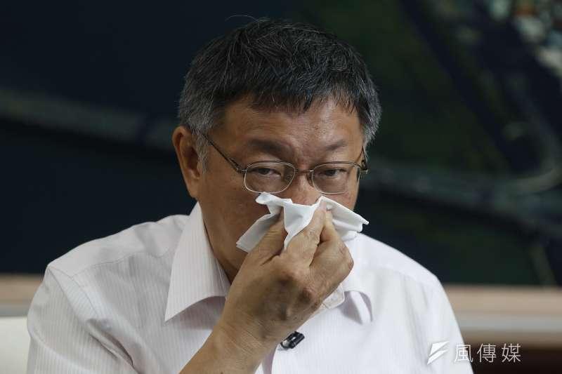 台北市長柯文哲16日接受風傳媒及新新聞專訪,談到和對岸協調世大運、蔡政府卻不肯幫忙的委屈,一度哽咽。(郭晉瑋攝)