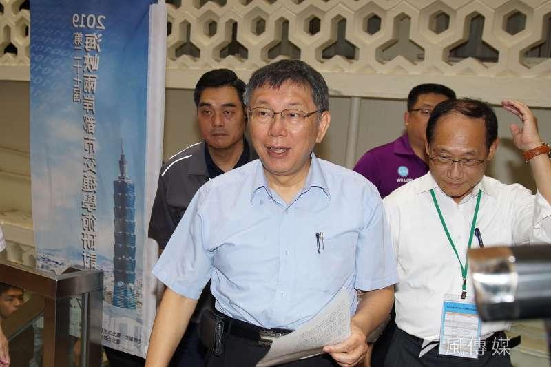 台北市長柯文哲(中)22日出席2019海峽兩岸都市交通研討會開幕式。(盧逸峰攝)
