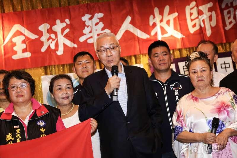 國民黨主席吳敦義(中)14日出席全球華人牧師藝術節活動。(簡必丞攝)