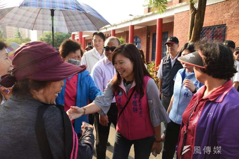 國名黨立委參選人李雅靜(中)認為,在物質條件上完全没法和主要對手相比,但她仍對勝選具有堅定的信心。(圖/徐炳文攝)