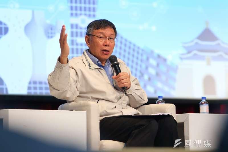 台北市長柯文哲(見圖)對藍綠各自估票數字笑說:「加起來除以2差不多。」(資料照,顏麟宇攝)