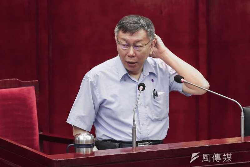 台北市長柯文哲(見圖)今(14)日赴市議會,針對新冠肺炎紓困及產業振興議題,進行專案報告。(簡必丞攝)