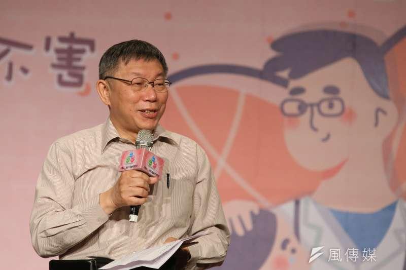 台北市長柯文哲(見圖)透露,接種AZ疫苗後當晚出現頭痛發燒現象。(柯承惠攝)