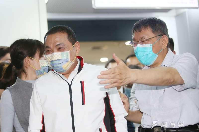 20210507-臺北市長柯文哲(右)與新北市長侯友宜(左)7日出席2025雙北世界壯年運動會組織委員會成立大會,兩人會後接受聯訪。(柯承惠攝)