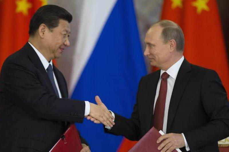 習近平與普京近兩年頻頻會面,中俄關係也有所進展。(美聯社)