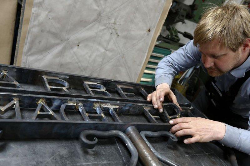 鐵匠波伊特納與達豪集中營的鐵門