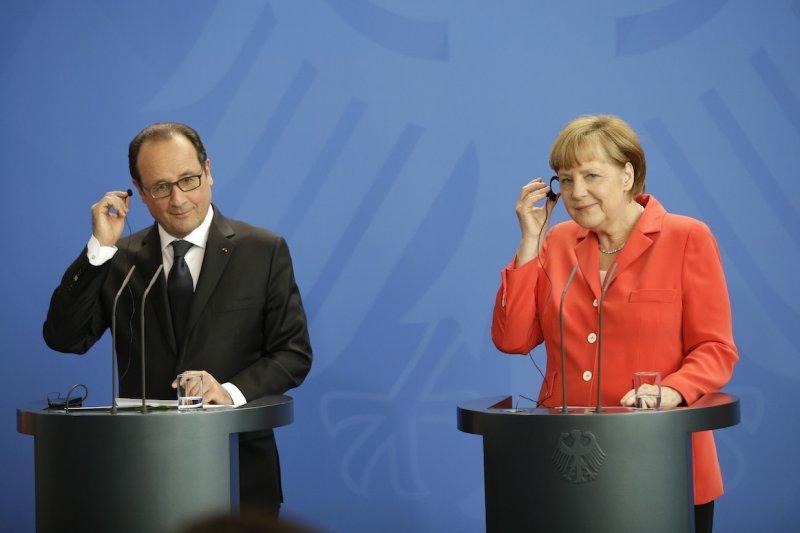 法國總統奧朗德(左)與德國總理梅克爾(美聯社)