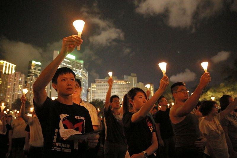 香港在九七後更像處於殖民地位嗎?(圖為香港六四紀念活動。美聯社)