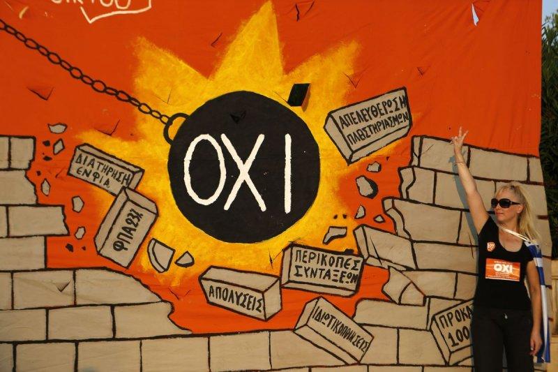 希臘反對國際紓困計劃的街頭塗鴉(美聯社)