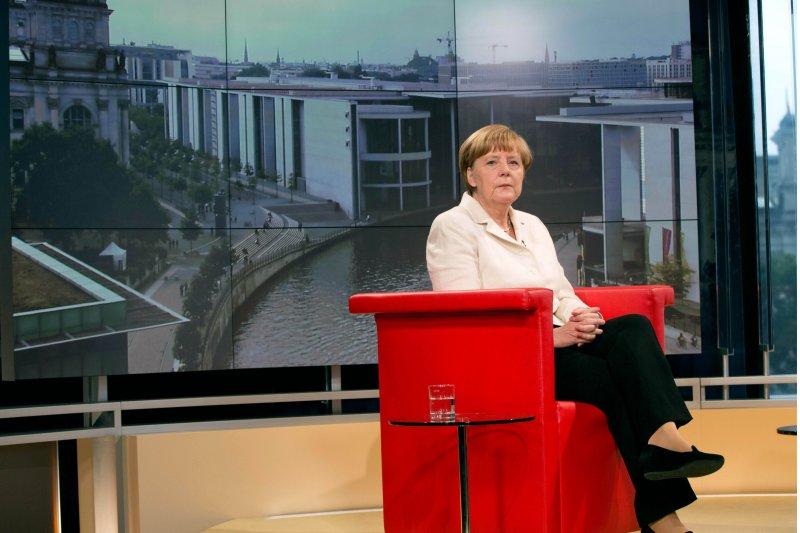 德國總理梅克爾19日接受電視專訪。(美聯社)