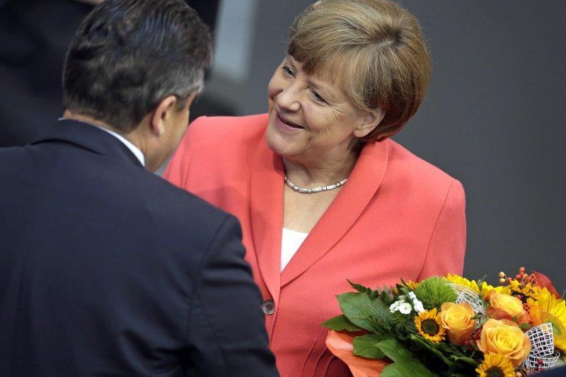 61歲的德國總理梅克爾宣布尋求四連任。(美聯社)
