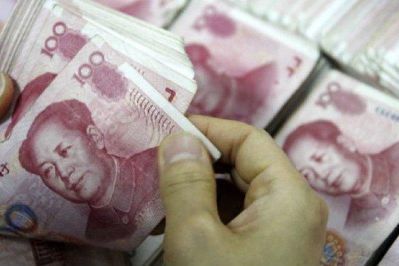 中國認為人民幣對美元匯率因為美國實施量化寬鬆的影響,匯率一直偏高。(BBC中文網)