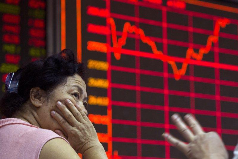 作者認為,針對中國股市,當前的課題已經不是「要不要」投資,而是「何時投資」以及「投資多少」的問題。(美聯社)