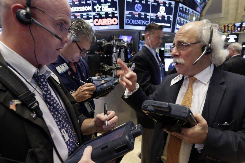 從美國華爾街掀起的金融海嘯最後席捲全球。(資料照片,美聯社)