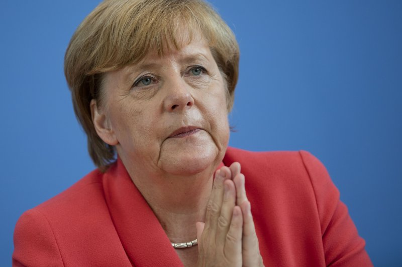 德國總理梅克爾決定一肩挑起照顧難民工作。(美聯社)