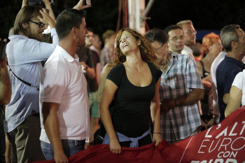 希臘國會選舉,激進左翼聯盟黨的支持者對開票結果相當滿意(美聯社)