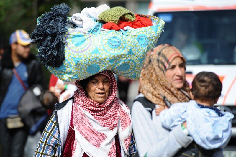 大批尋求庇護的難民與移民抵達德國慕尼黑。(美聯社)